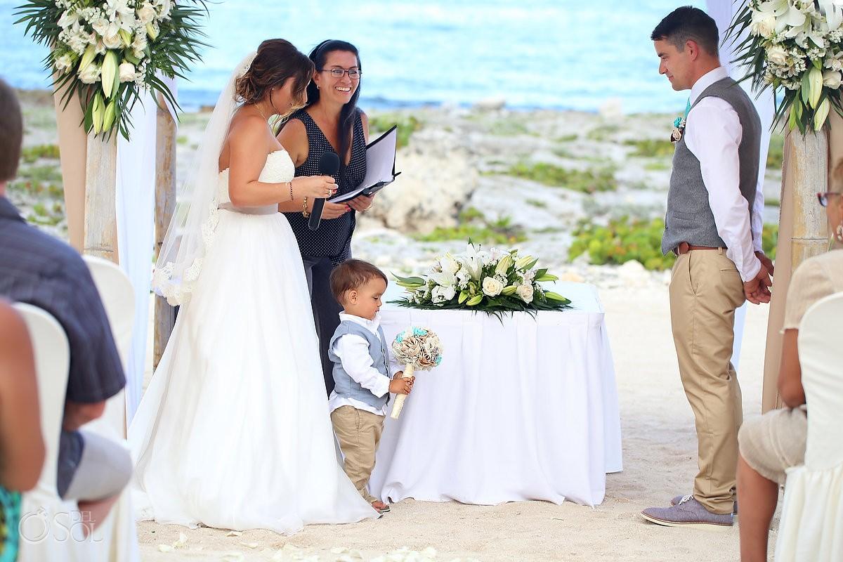 Child holds brides boquet beach Wedding at Grand Sirenis Riviera Maya, Mexico.