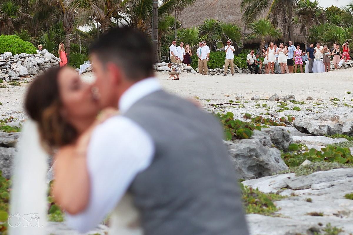guest watch bride hgroom kiss beach Wedding at Grand Sirenis Riviera maya, Mexico