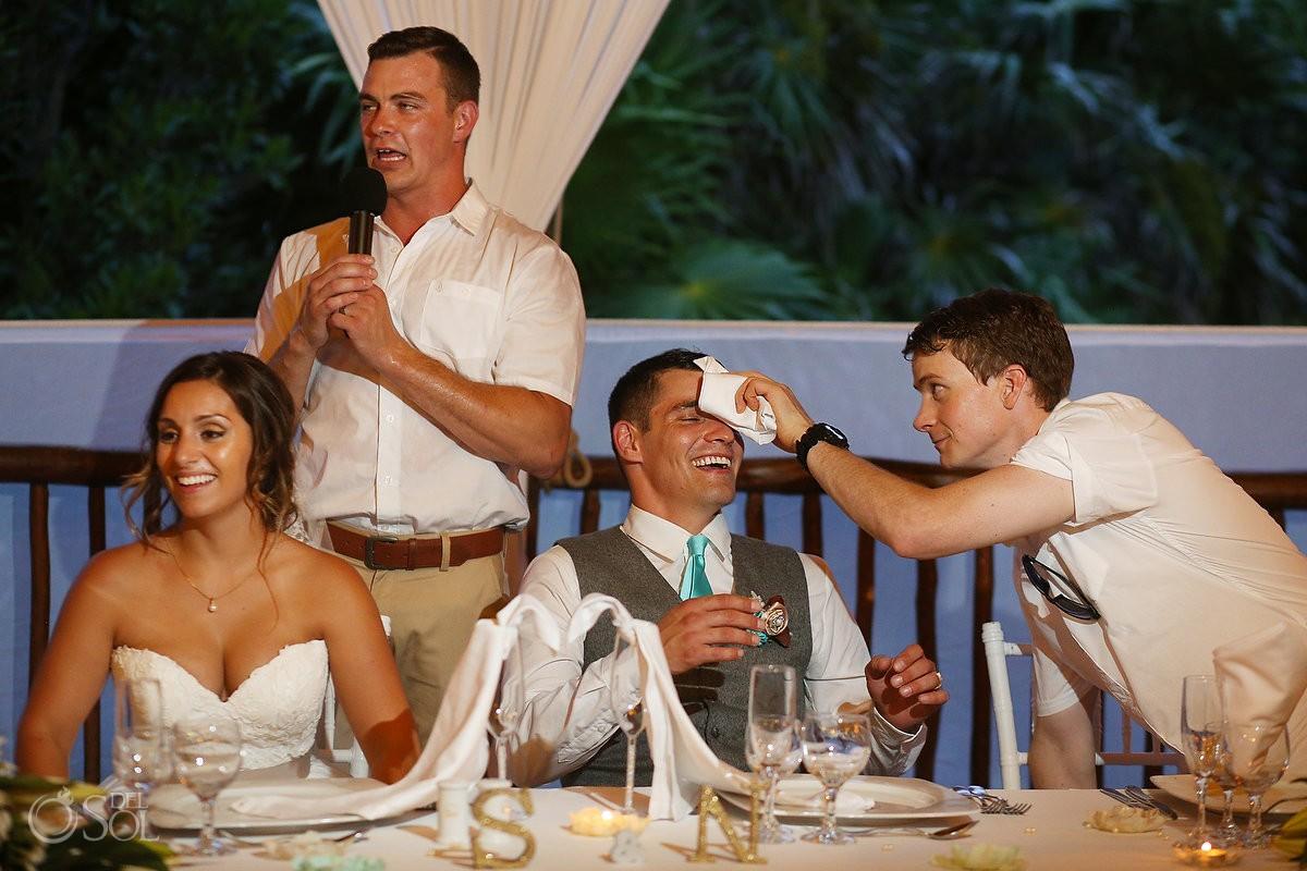 sweating groom beach Wedding reception at Grand Sirenis Riviera maya palapa, Mexico