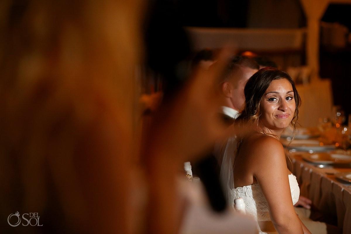 Bride watches speech, beach Wedding reception at Grand Sirenis Riviera maya palapa, Mexico