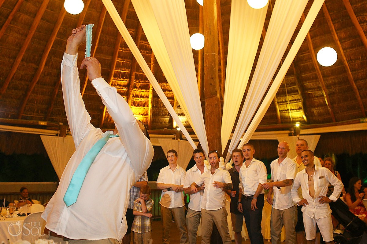 garter toss beach Wedding reception at Grand Sirenis Riviera maya palapa, Mexico