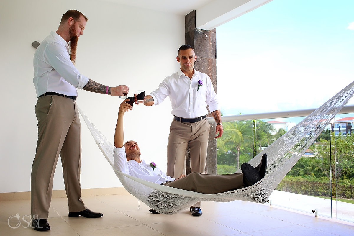 Groom getting ready with groomsmen at Grand Coral Apartments, Playa del Carmen, Mexico
