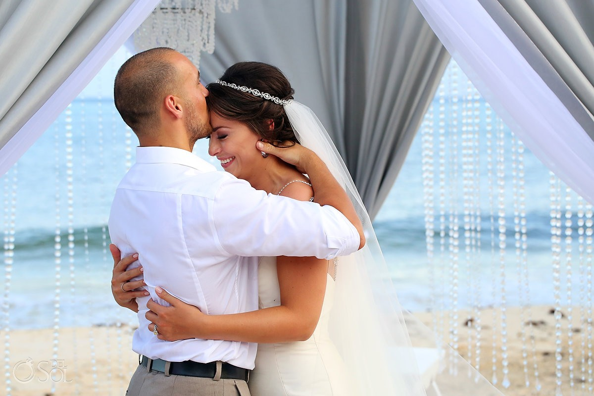 bride and groom kiss wedding Grand Coral Beach Club, Playa del Carmen