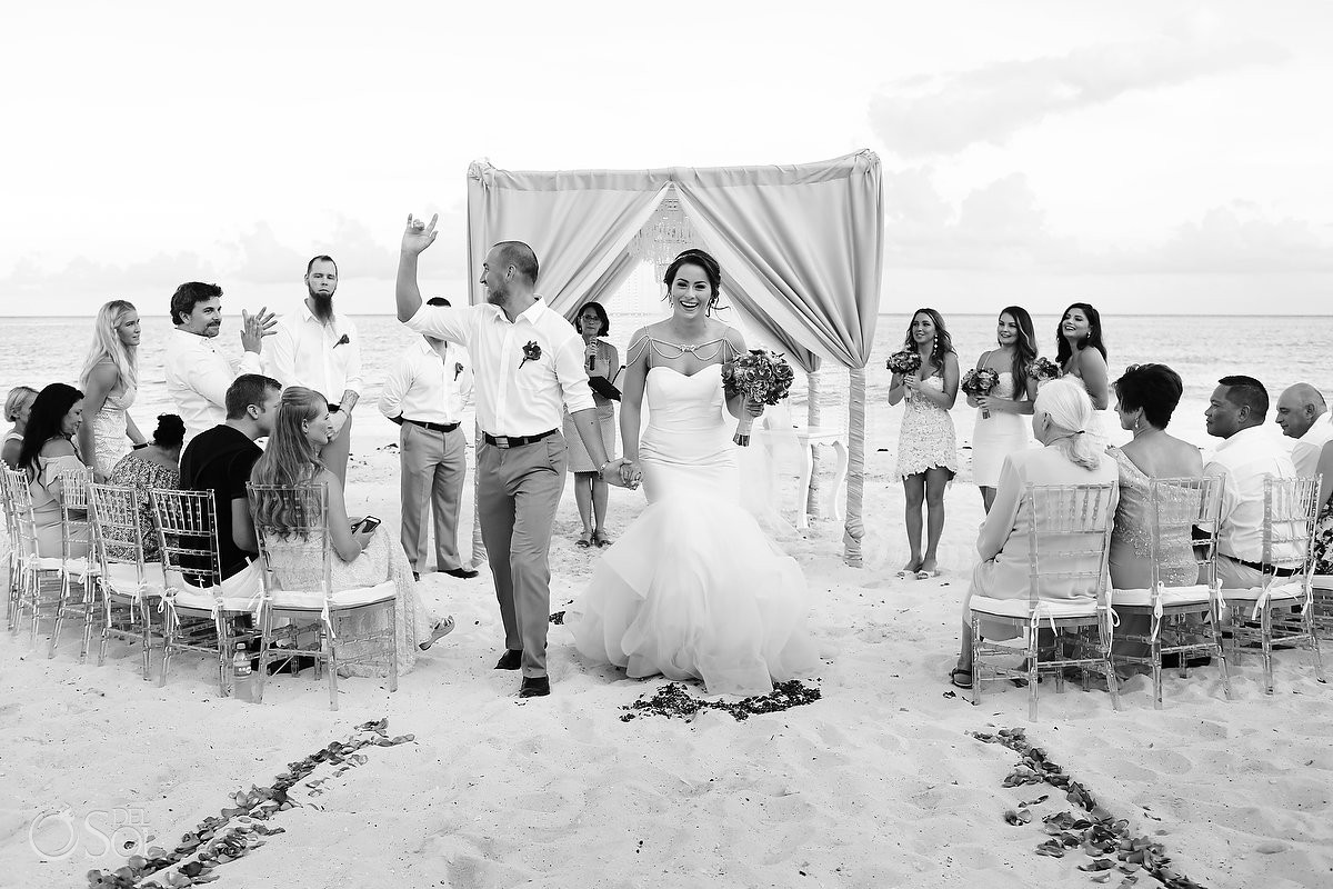Beach wedding ceremony exit high five Grand Coral Beach Club, Playa del Carmen