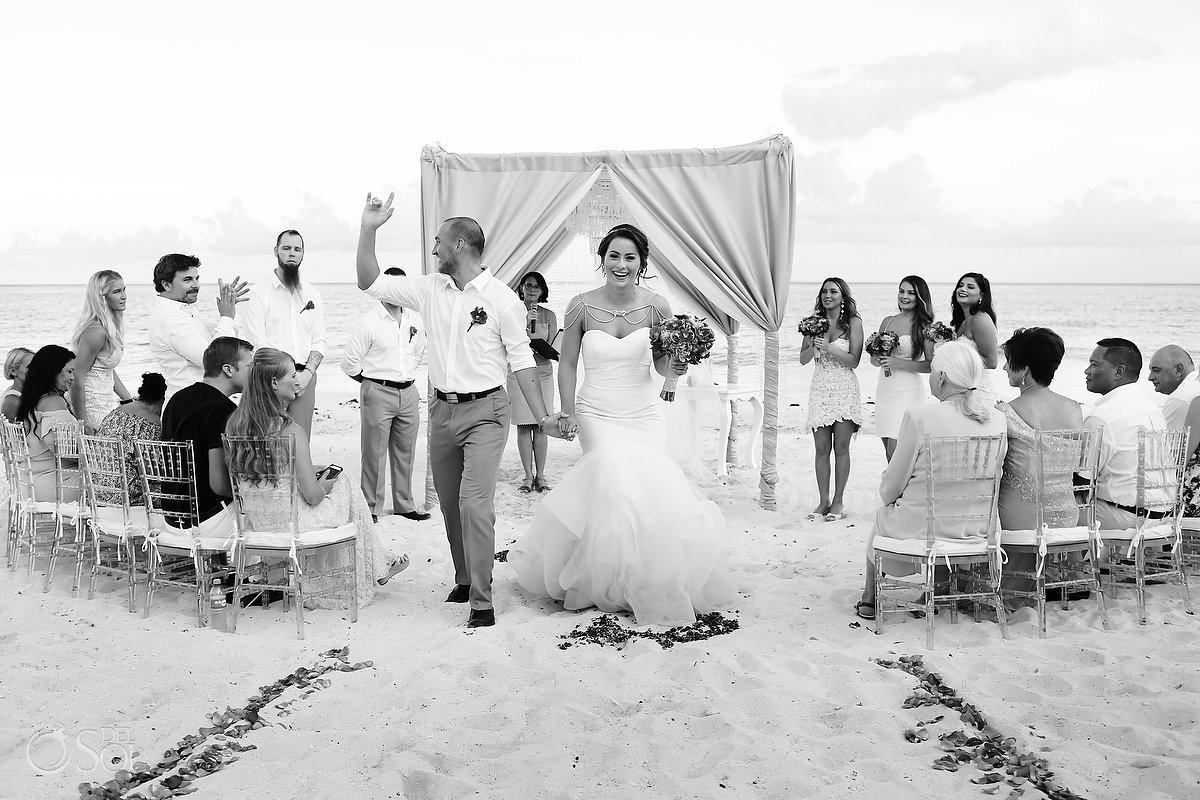 Beach wedding ceremony exit high five Grand Coral Beach Club, Playa del Carmen