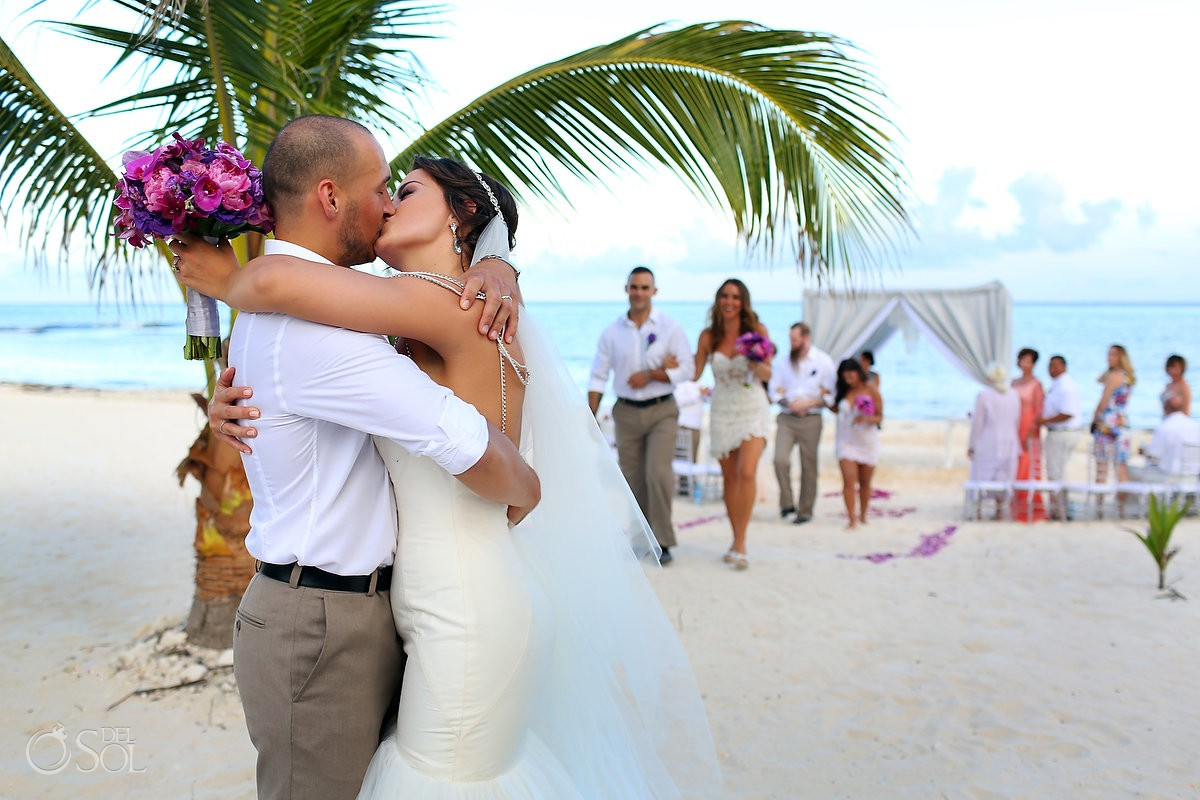 Bride groom kiss beach wedding ceremony Grand Coral Beach Club, Playa del Carmen