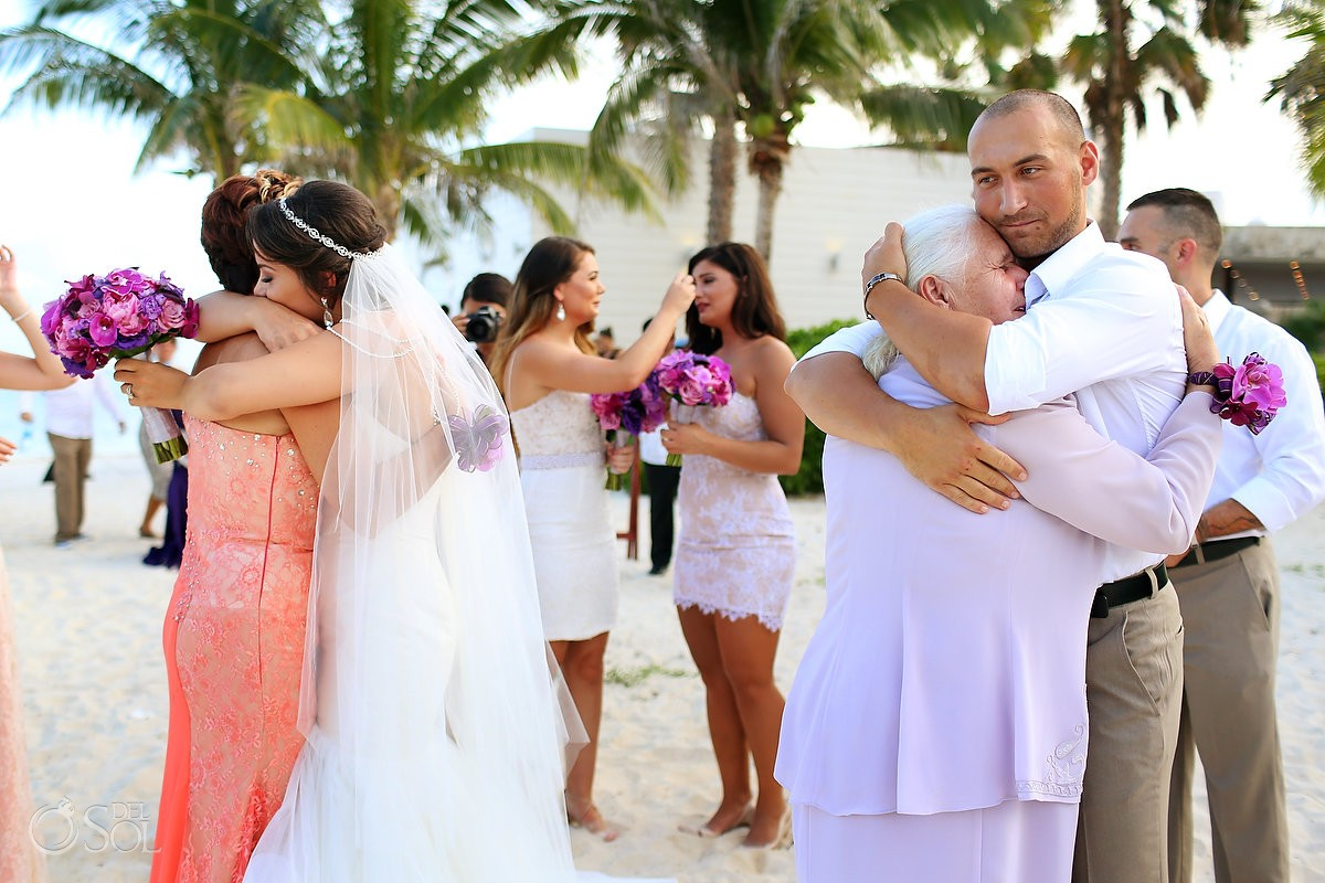 Emotional family hugs beach wedding ceremony Grand Coral Beach Club Riviera Maya