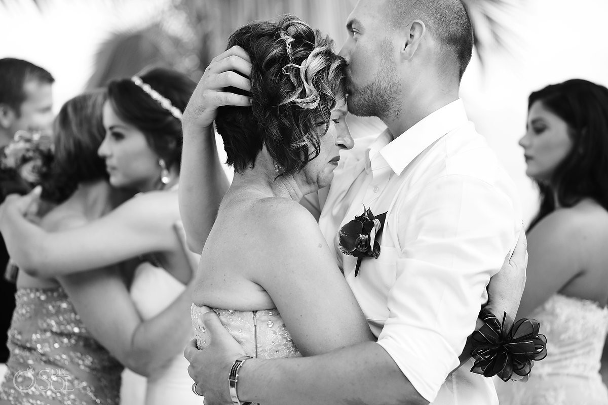 Groom mother emotional wedding hug black and white Grand Coral Beach Club