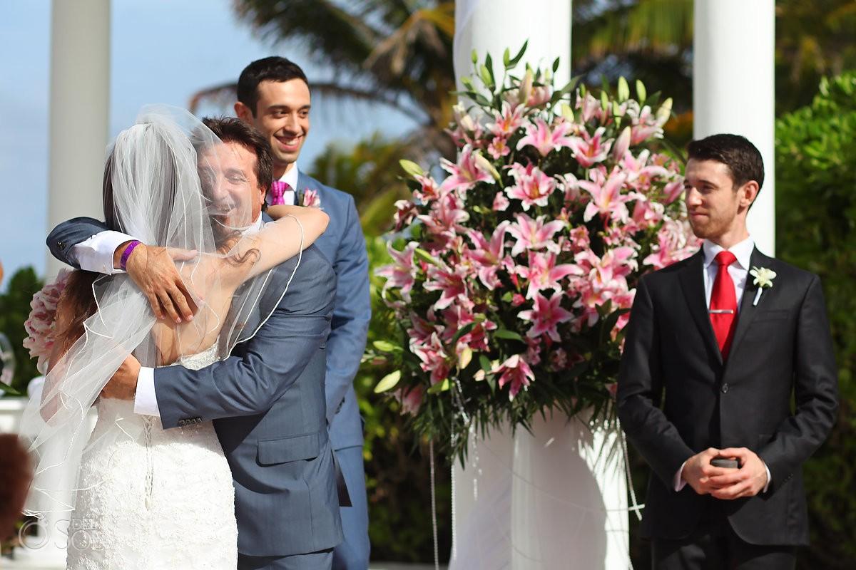 father of the bride hugs Wedding at Grand Palladium