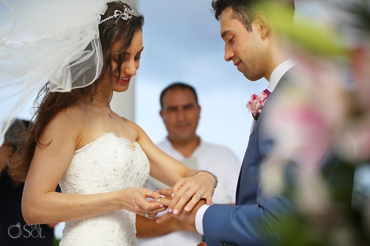 wedding ring exchange bride and groom at Grand Palladium