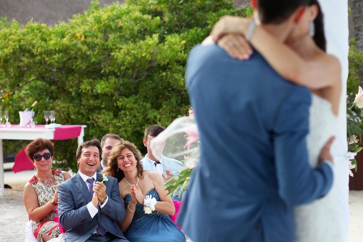 parents celebrating first kiss Wedding at Grand Palladium