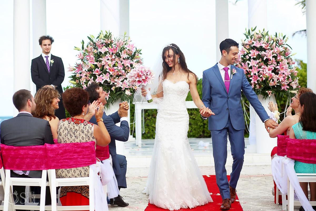 bride and groom celebrating Wedding at Grand Palladium