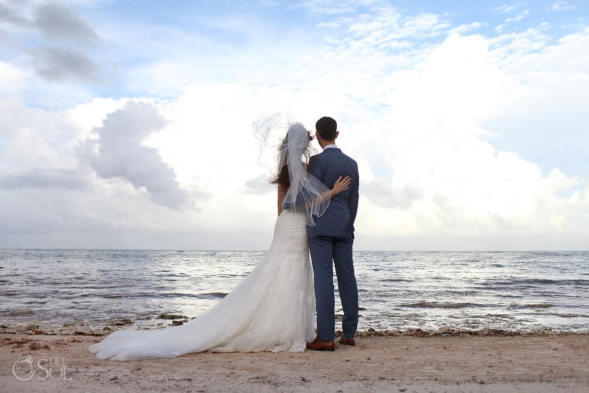bride and groom first kiss Wedding at Grand Palladium