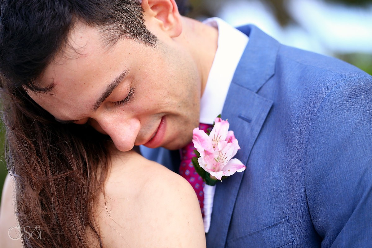 groom loving bride at grand palladium