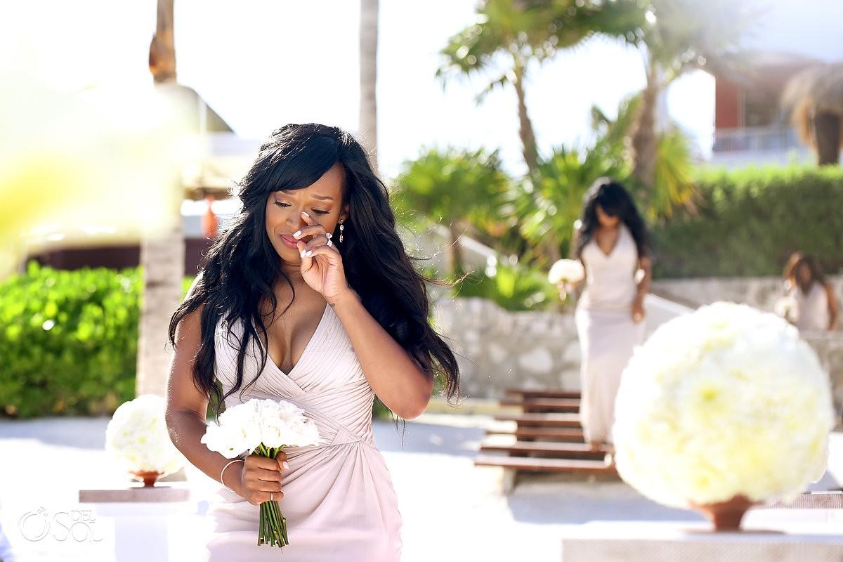 bridesmaid crying walking down the isle at Hard Rock Hotel