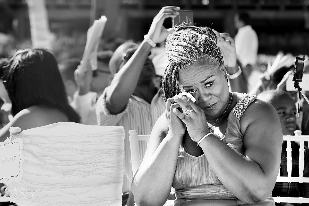 sensitive mother of the bride crying in a wedding at Hard Rock Hotel Riviera Maya