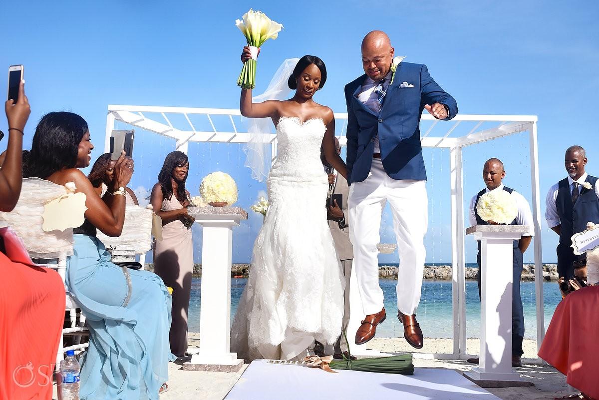 jumping the broom tradition at Hard rock riviera Maya beach Wedding