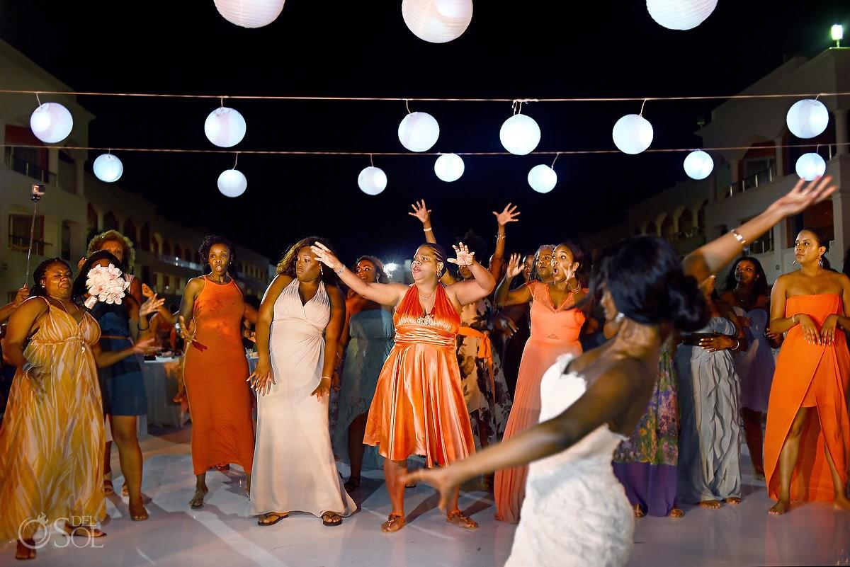 bride throws garter belt wedding reception at Hard Rock Hotel Riviera Maya
