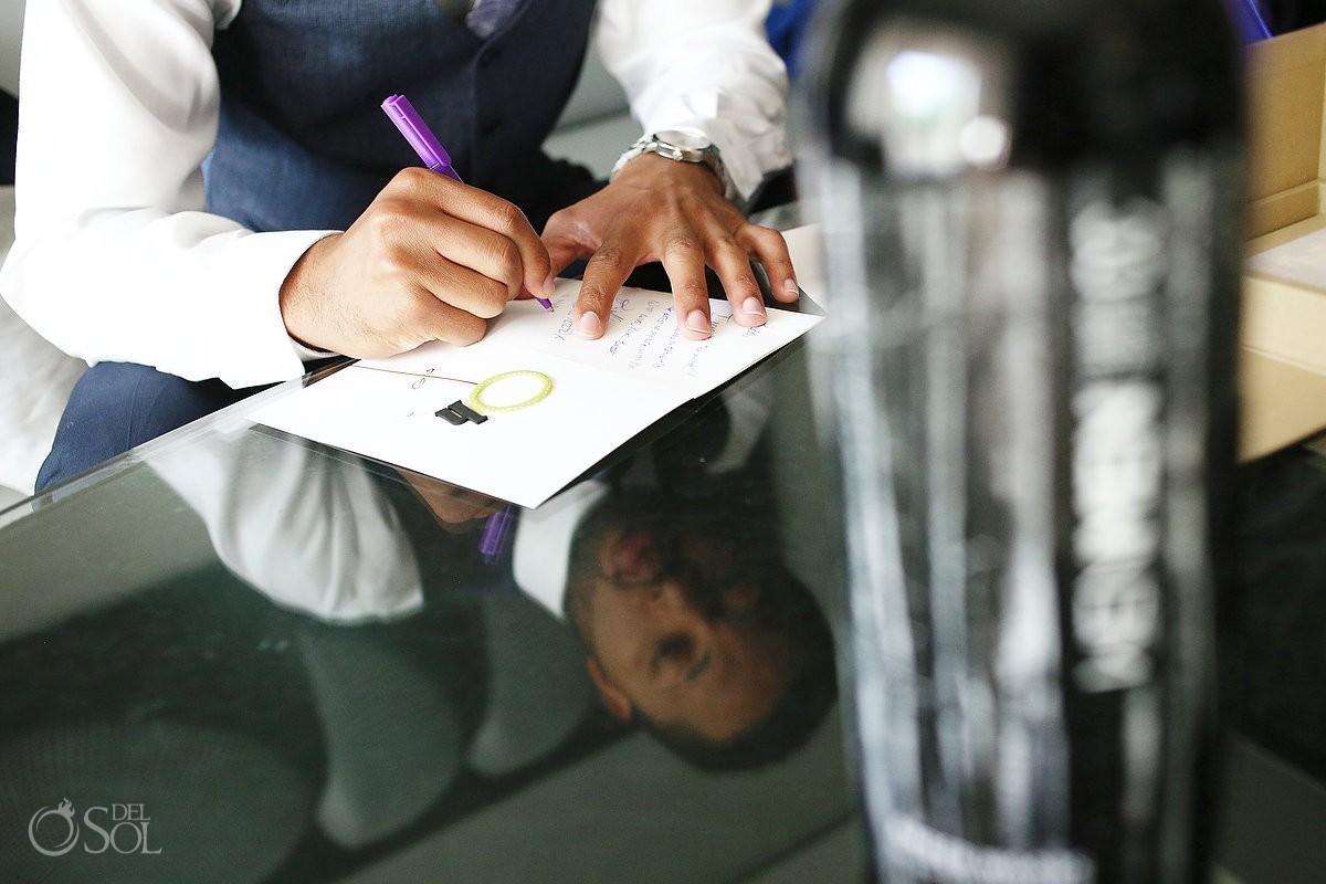 groom writing note to bride for Wedding at Paradisus, Playa del Carmen