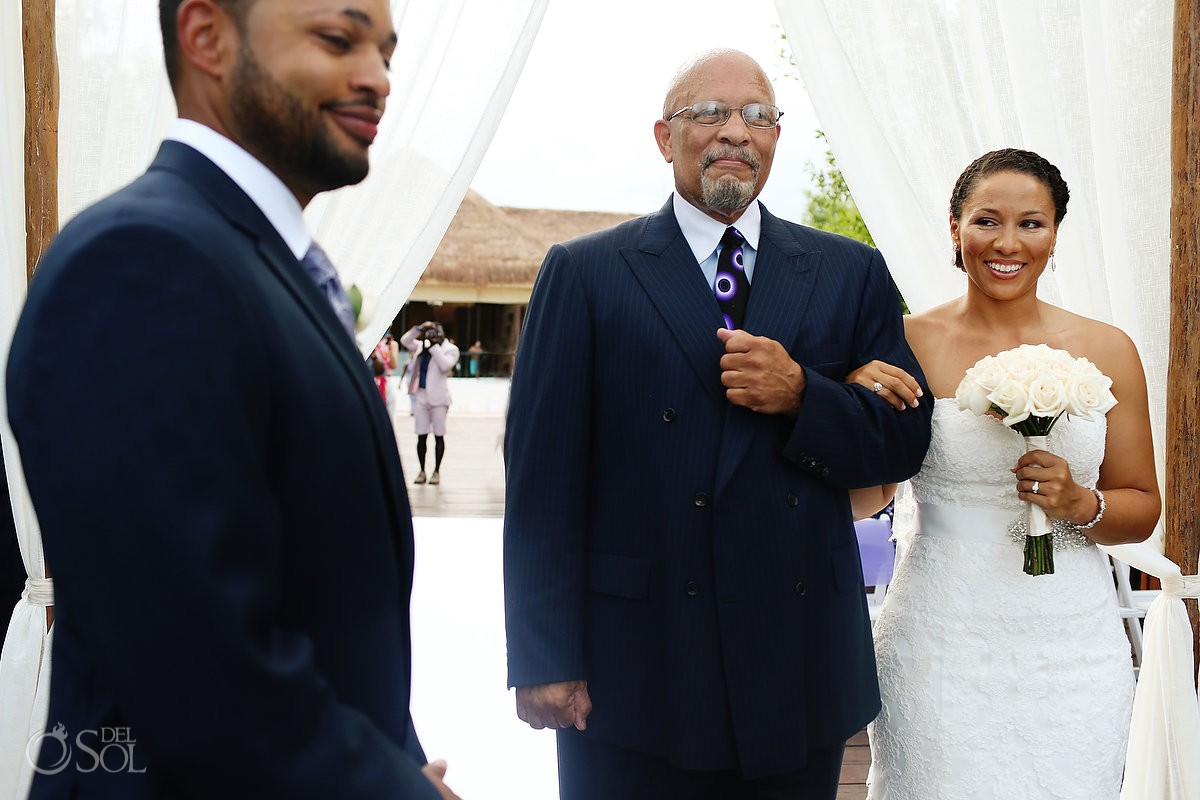 father and his daughter walk down the isle