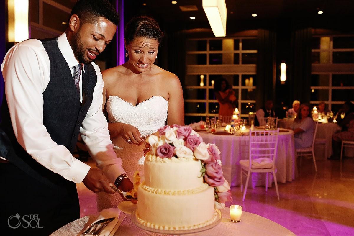 bride and groom cut cake for Wedding at Paradisus, Playa del Carmen