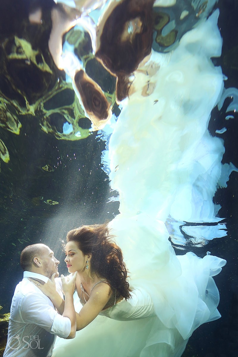 couple underwater wedding photography, cenote trash the dress, Riviera Maya, Mexico