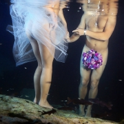 naked bride and groom with bouquet between legs, underwater boudoir sexy trash the dress