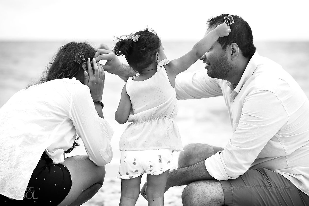 Parents child family love black white Playa Paraiso, Riviera Maya, Mexico.