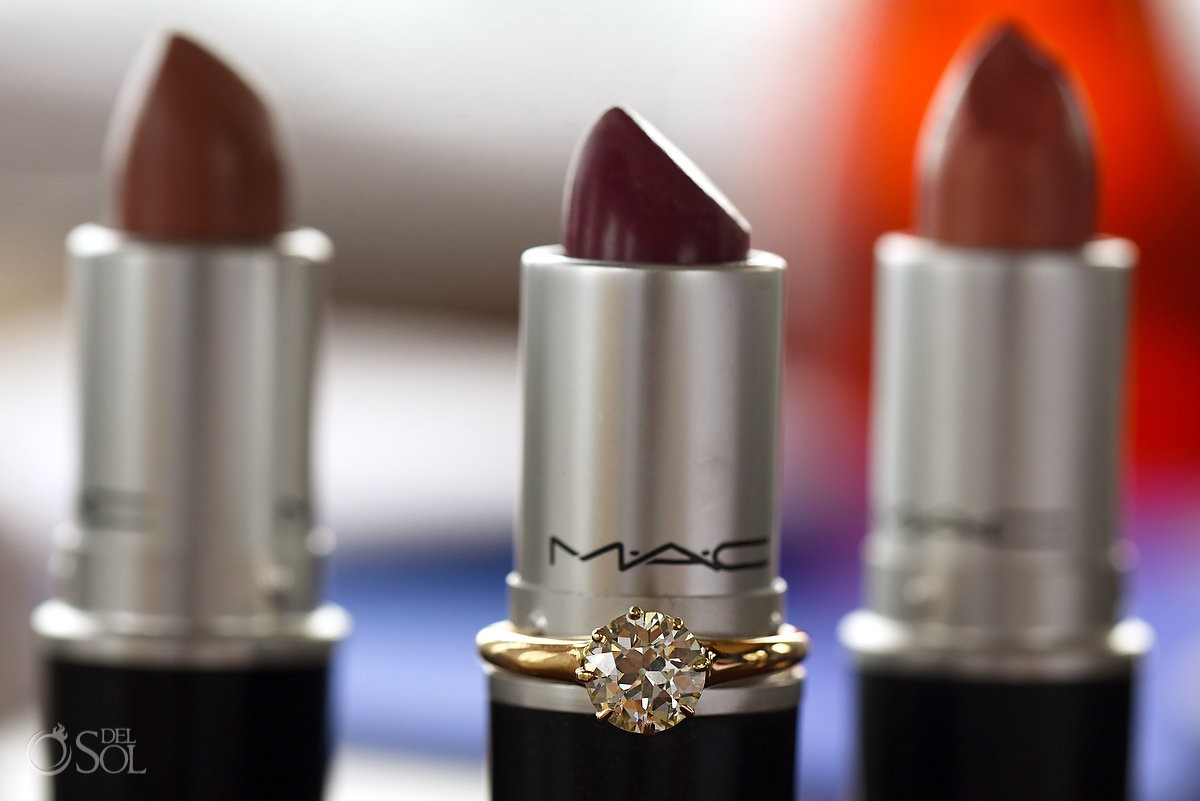 princess cut diamond engagement ring on Mac Makeup Lipstick tube
