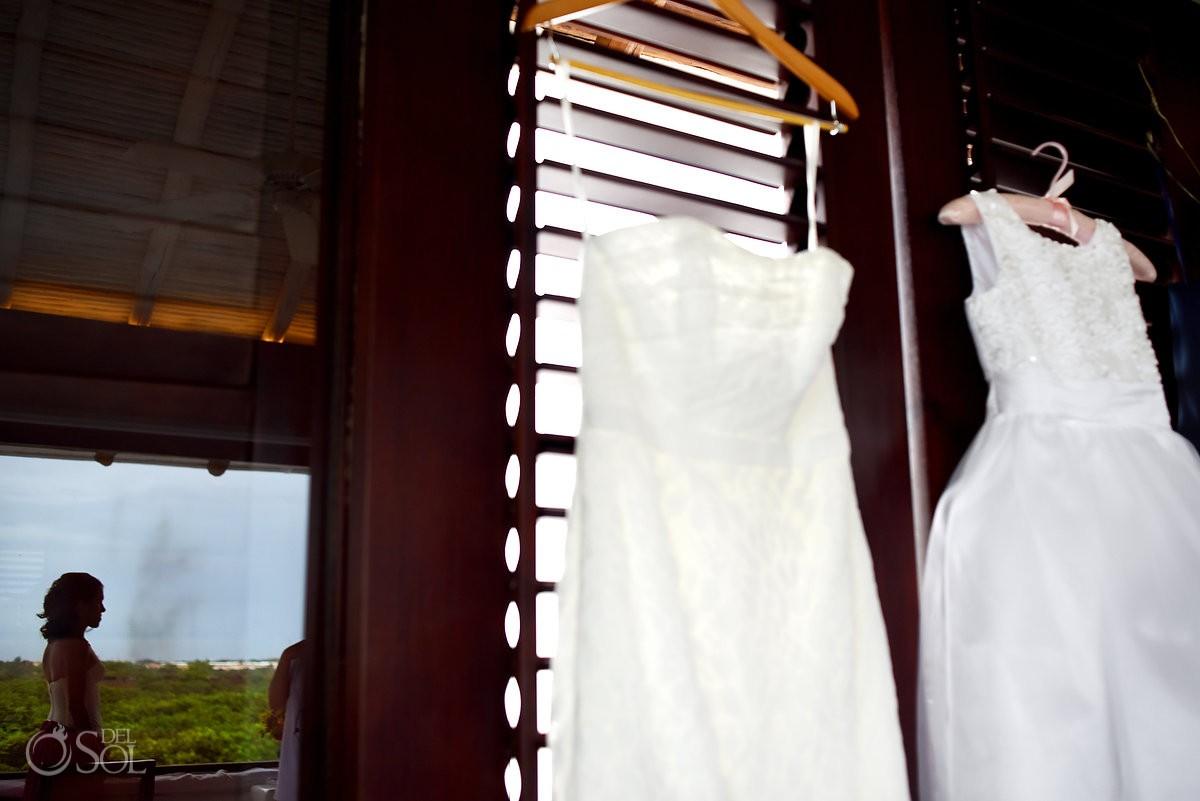 bride getting ready at hotel esencia w/ hanging wedding dress