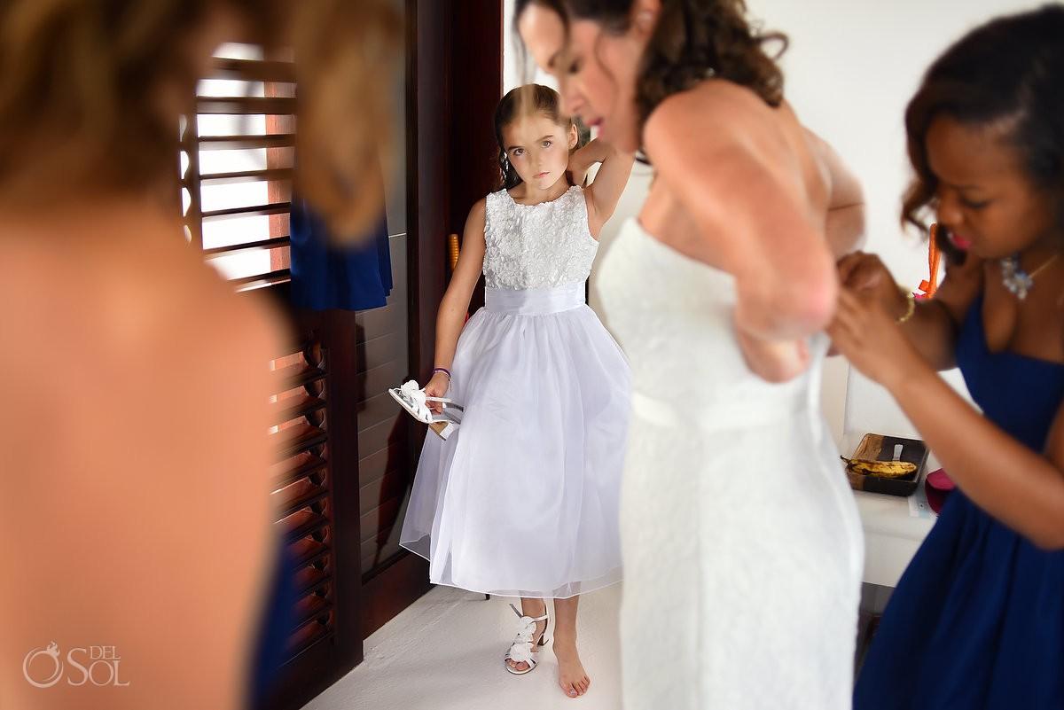 bride getting ready at hotel esencia with wedding dress