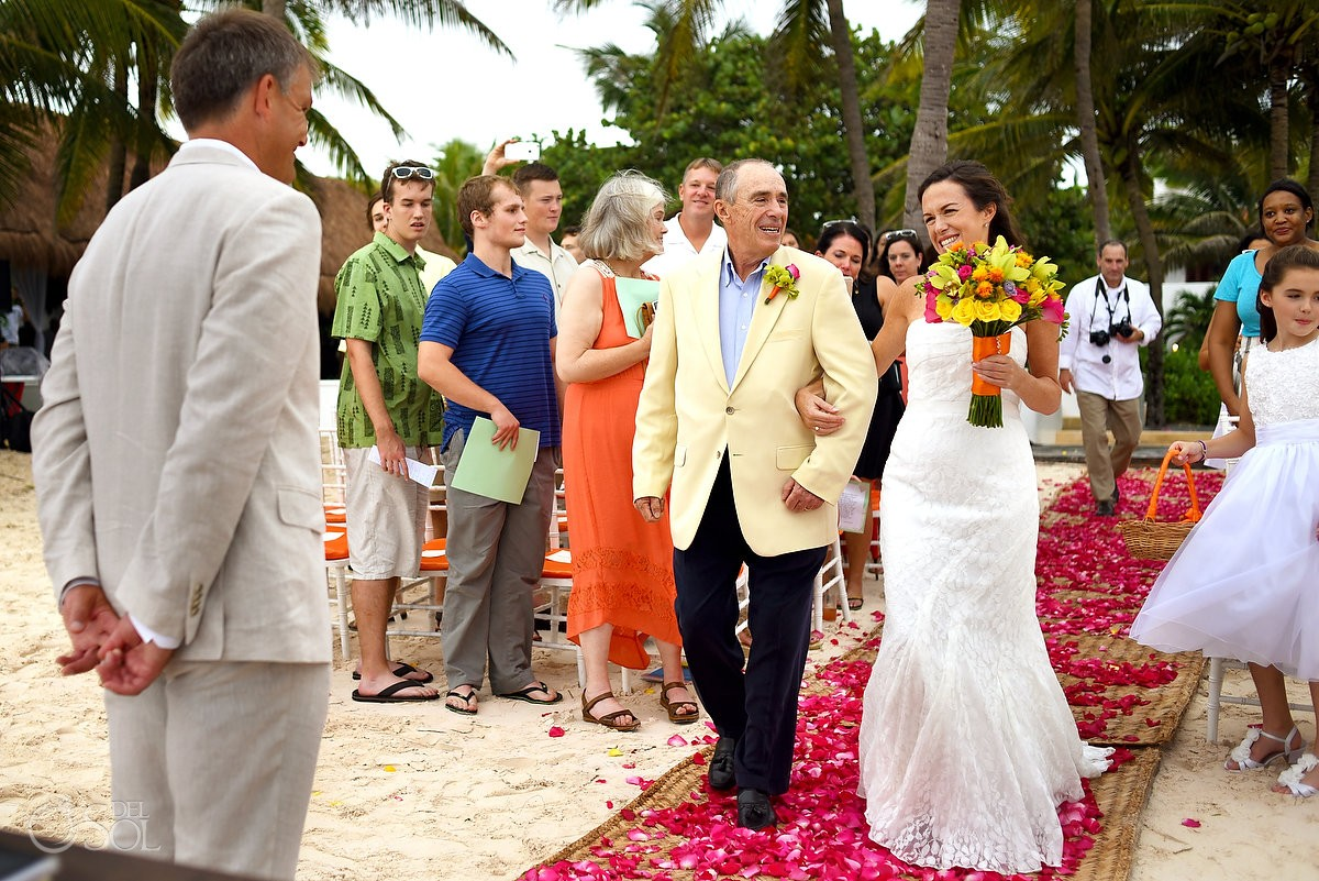 bride looks at groom during wedding processional at hotel esencia