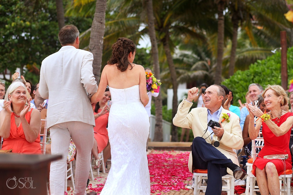 wedding recessional with guests celebrating at hotel esencia