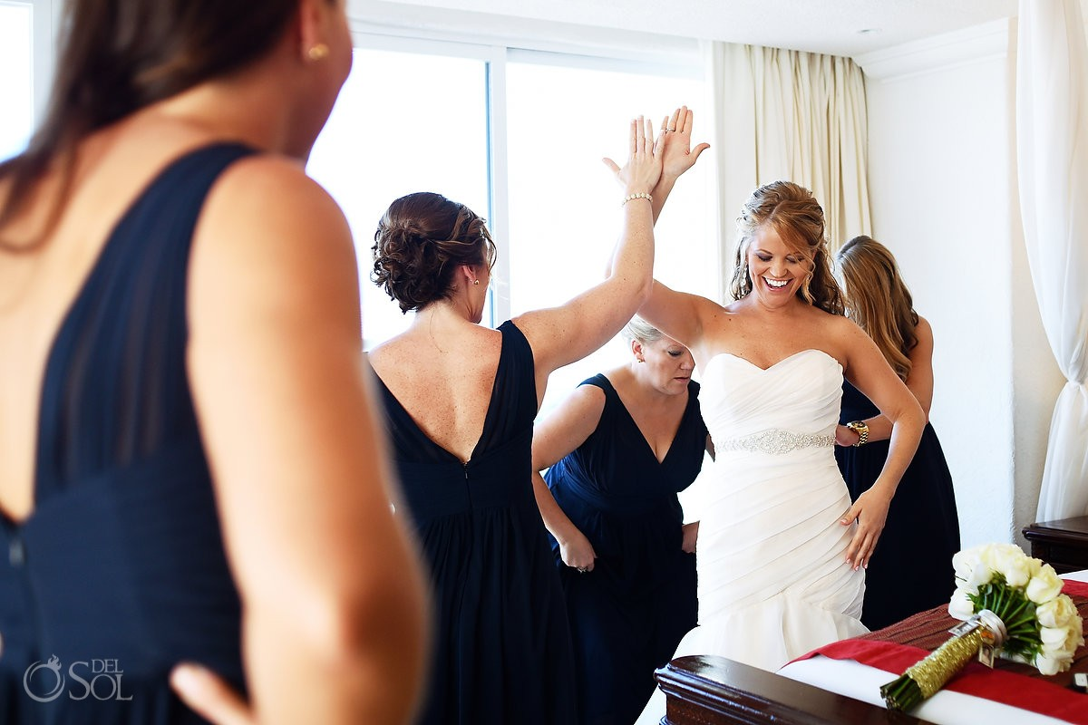 Bride getting ready high five celebration Caribe Real Cancun
