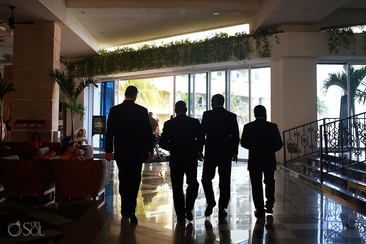Groomsmen getting ready silhouettes walking Caribe Real Cancun lobby
