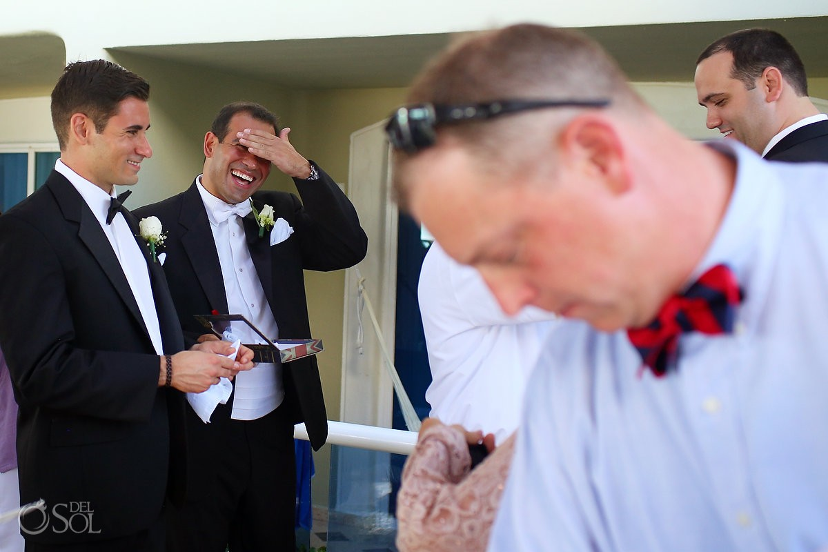 Groom laughing with groomsmen our lady Guadalupe Chapel Cancun wedding