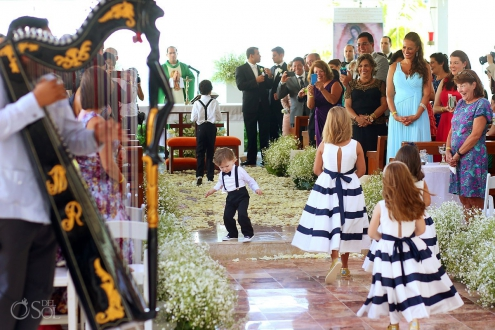 Cute kid ring bearer funny wedding picture lady Guadalupe Chapel Cancun