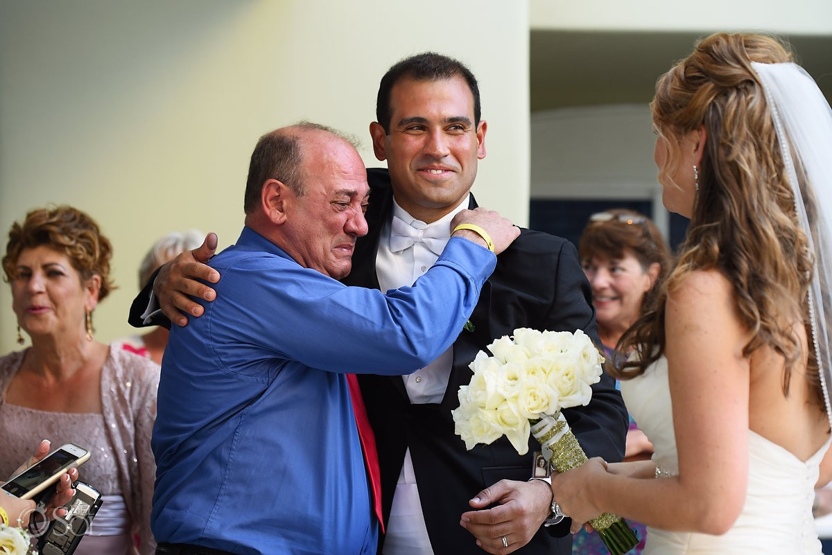 emotional hugs wedding ceremony our lady Guadalupe Chapel Cancun
