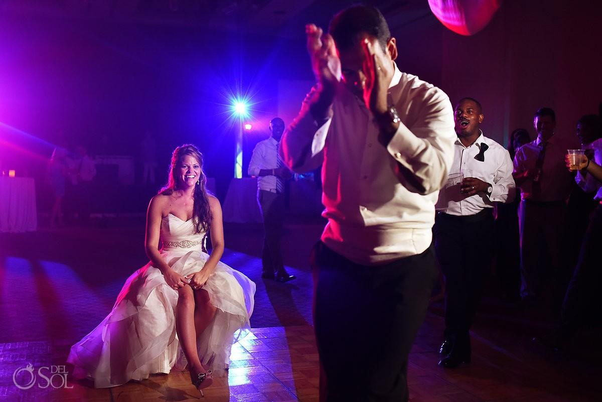 Garter toss wedding reception Gran Caribe Real Ballroom