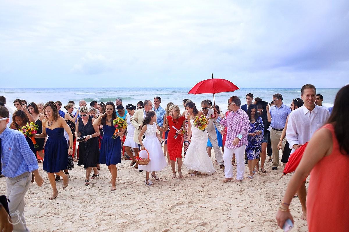 wedding day bridal party runs away from the rain at hotel esencia