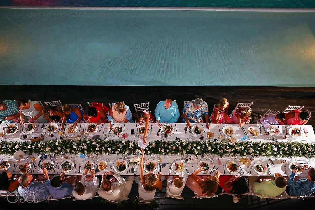 Table setting poolside Wedding reception Grand Coral Beach Club, Playa del Carmen, Mexico.