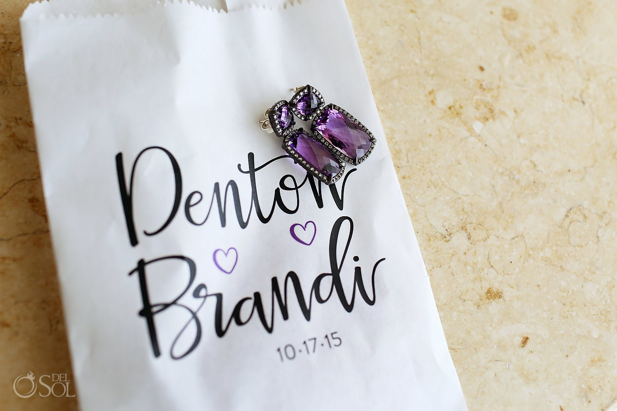 Wedding details: personalized paper bag names, purple earrings