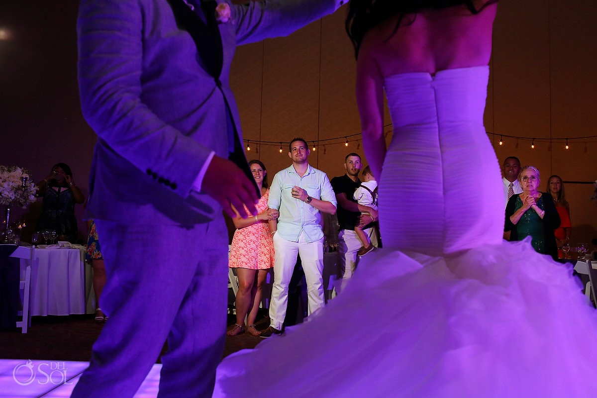 Guest watches first dance wedding reception Lakeside terrace, Moon Palace, Cancun, Mexico