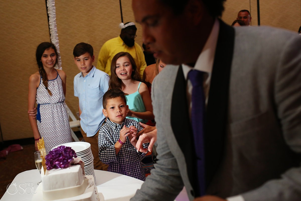 cute kids watching cake cutting wedding reception Lakeside terrace, Moon Palace, Cancun, Mexico