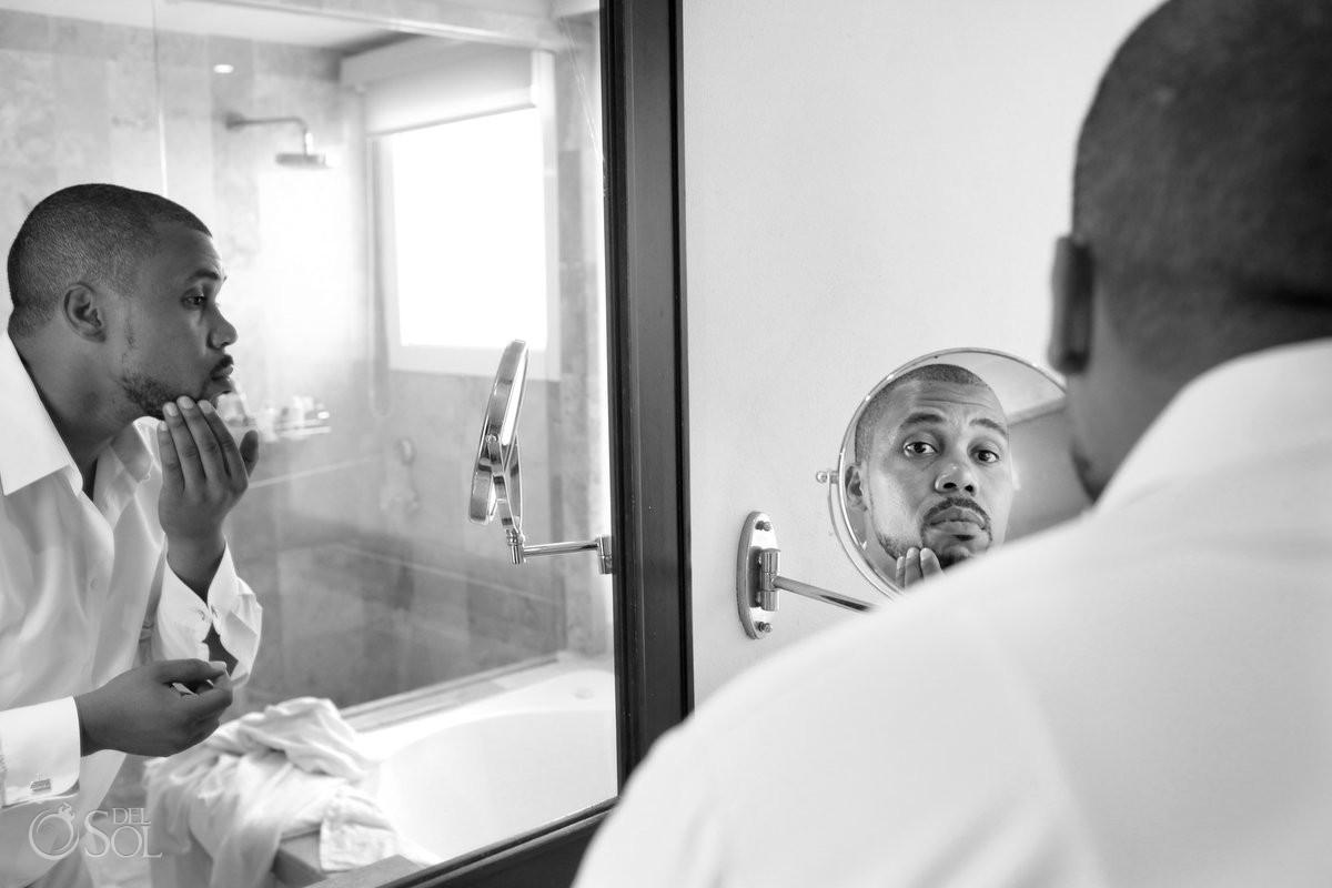 Black African American chocolate groom getting ready mirror Now Jade Riviera Maya Mexico