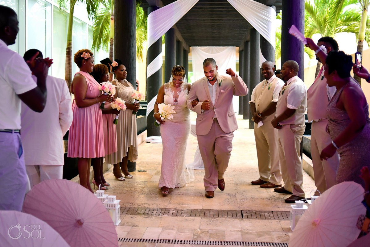 Black African American chocolate wedding ceremony exit celebration pink light inside rain Now Jade Riviera Maya Mexico