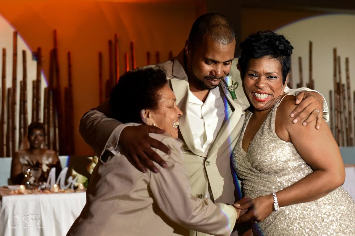 Wedding reception family hugs Now Jade Riviera Maya Mexico