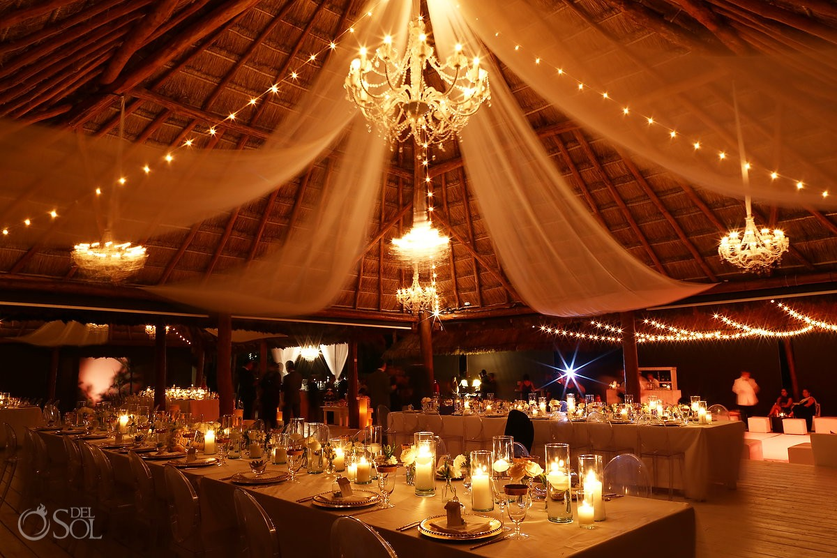 Palapa wedding reception setting chandelier tables, Rosewood Mayakoba, Playa del Carmen, Mexico