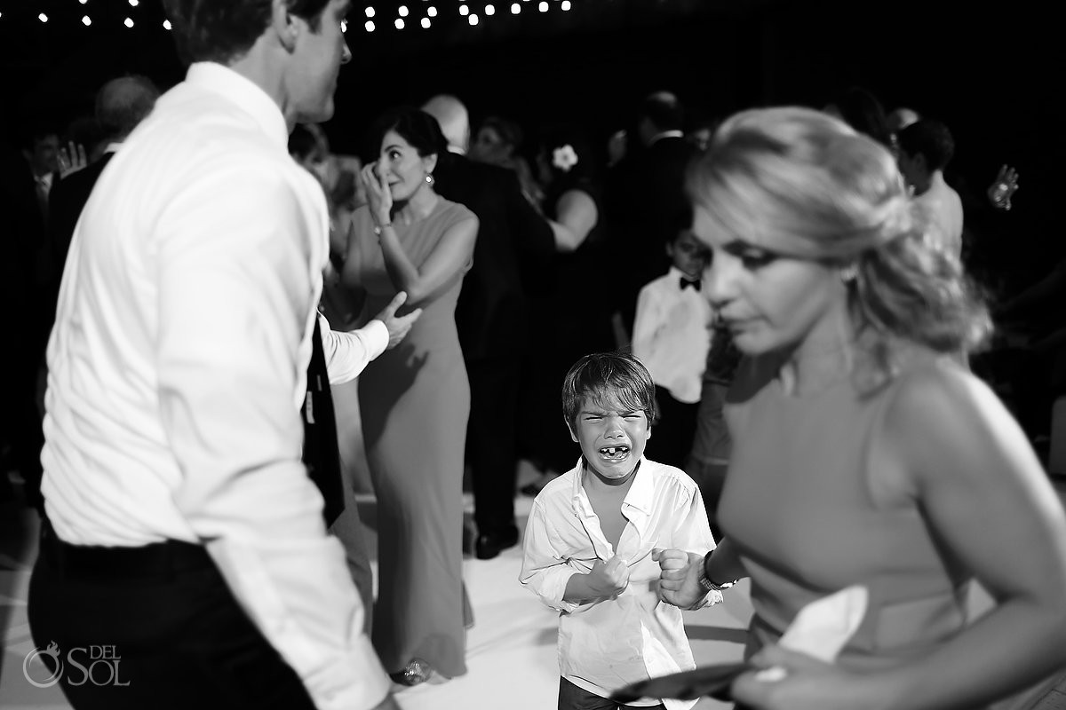 Cute kid funny teeth wedding reception Rosewood Mayakoba, Playa del Carmen, Mexico