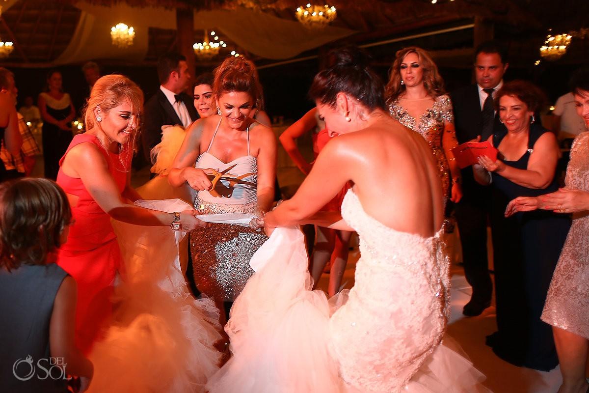 Bride cutting wedding dress, funny wedding photo, Rosewood Mayakoba, Playa del Carmen, Mexico